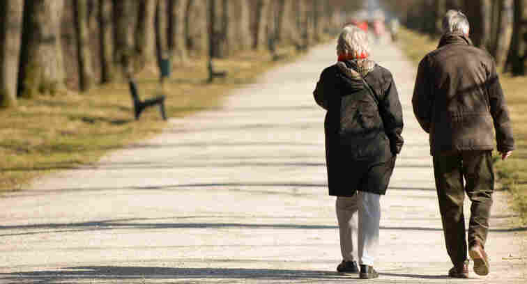 Two pensioners walking.