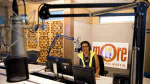 "Host Michel Martin poses in the Tell Me More studio at NPR headquarters in Washington, D.C. Although the show is ending, Michel says there are ""many stories yet to tell."""