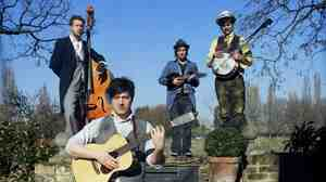 Banjo! Exposed brick! Open sky! Still, Mumford and Sons, you could use some hay bales...