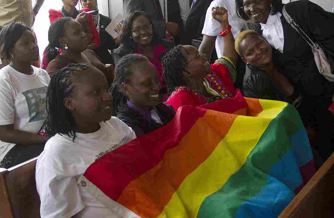Members of Uganda's gay community and gay rights activists react after the constitutional court overturned an anti-gay law.