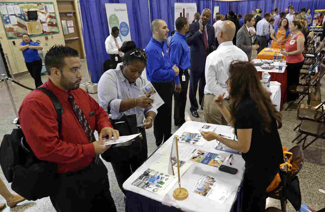 People attend a hiring fair for veterans in Fort Lauderdale, Fla., July 16. About 7.5 million people in the U.S. are working less than 40 hours per week even though they want full-time jo