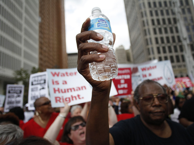 Demonstrators protest against the Detroit Water and Sewerage Department last month. Thousands of the city's customers are behind on their water payments.