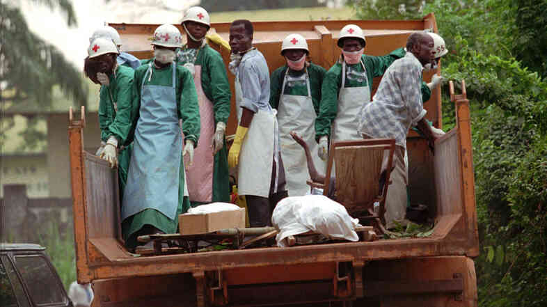In 1995, amid an Ebola outbreak, Zairian Red Cross personnel picked up sick people and bodies left on the streets of Kikwit, 250 miles from the capital Kinshasa.