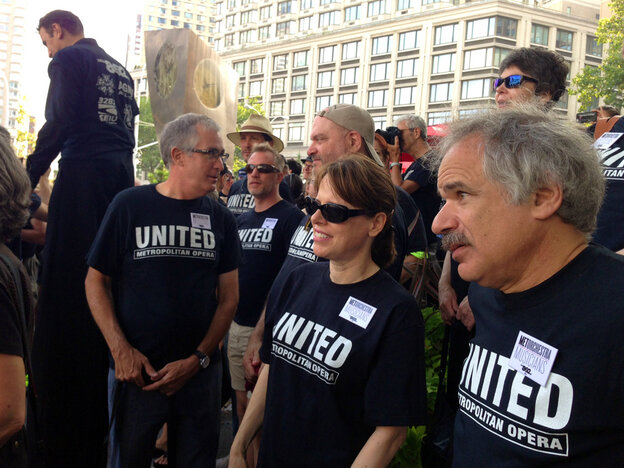 Members of the American Guild of Musical Artists and the American Federation of Musicians, two of the unions embroiled in contract negotiations with Metropolitan Opera management, rally this morning at Dante Park across from Lincoln Center.