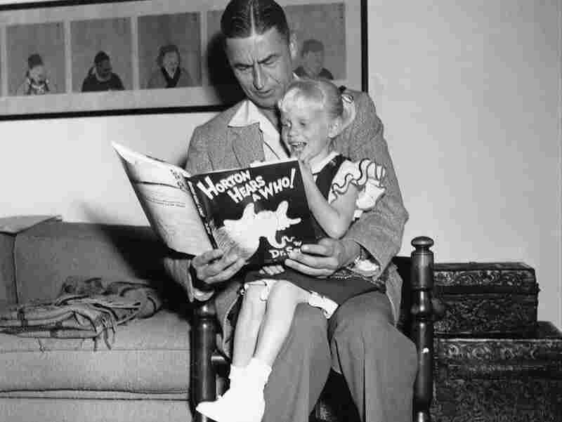 Author and illustrator Theodor Seuss Geisel, known as Dr. Seuss, reads from his book Horton Hears a Who! to 4-year-old Lucinda Bell at his home in La Jolla, Calif., in 1956.