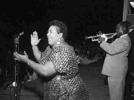 Velma Middleton is accompanied by Louis Armstrong at the 1955 Newport Jazz Festival.