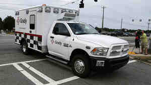 An ambulance departs Dobbins Air Reserve Base in Marietta, Ga., Saturday. Dr. Kent Brantly, an American infected with the Ebola virus, was transferred to Emory University Hospital in Atlanta today.