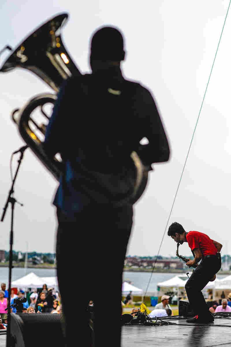 Eddie Barbash is framed by tuba player Ibanda Ruhumbika.