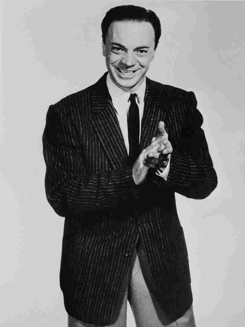 Freed claps out the beat in a promotional picture taken for a Rock 'n' Roll Revue show he hosted in 1957