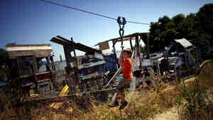 "Joseph Straus, 6, rides a zip line at the Berkeley Adventure Playground, where kids can ""play wild"" in a half-acre park that has a junkyard feel."