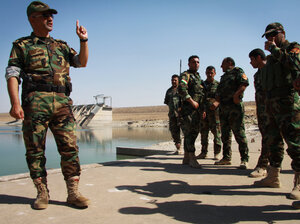 Brig. Gen. Mohammad Ali Mughdeed talks to the men he commands to protect the Mosul dam, a critical piece of infrastructure that supplies water and electricity. The dam recently fell t