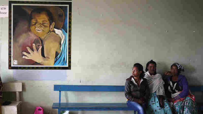 Family members sit in the waiting room for the neonatal unit at Black Lion hospital.