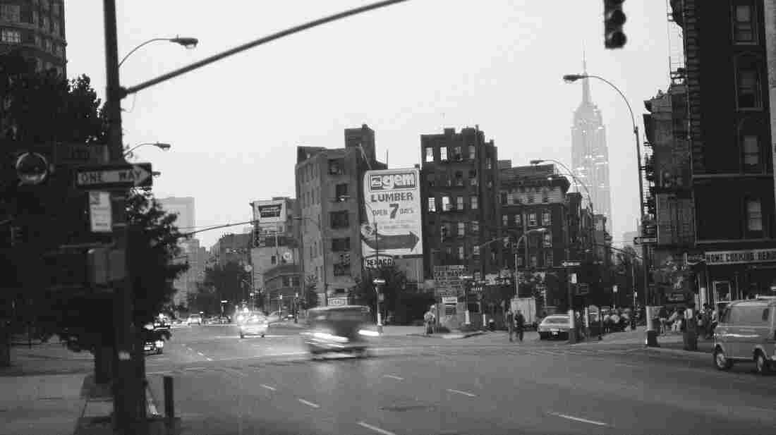 The Empire State Building shines while Greenwich Village remains dark during the 1977 New York City blackout.