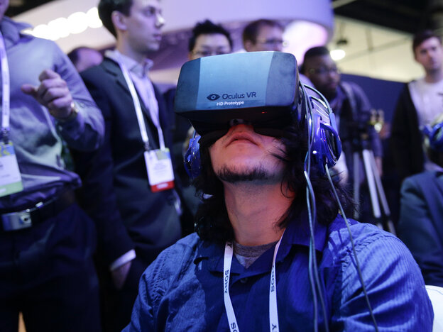 Attendees play a video game wearing Oculus Rift virtual reality headsets at the International Consumer Electronics Show in Las Vegas in January.