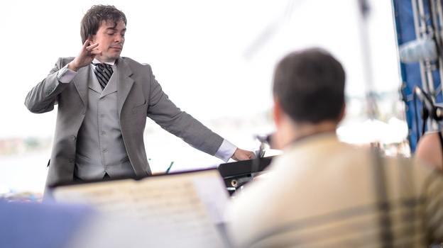 Darcy James Argue conducts the Secret Society in a new big-band piece at the 2014 Newport Jazz Festival. (Adam Kissick for NPR)
