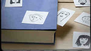 A book with a set of sketches of people.