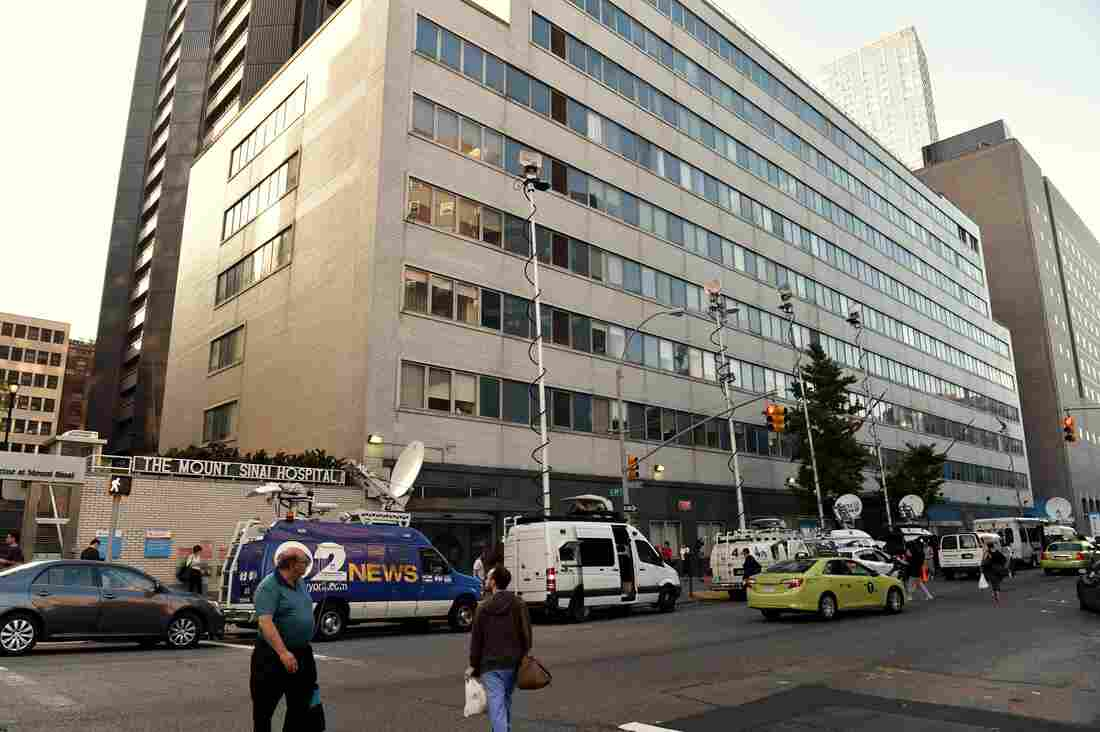 Television trucks converged on Mount Sinai Hospital in New York on Monday after it announced that it was screening a patient for Ebola virus.