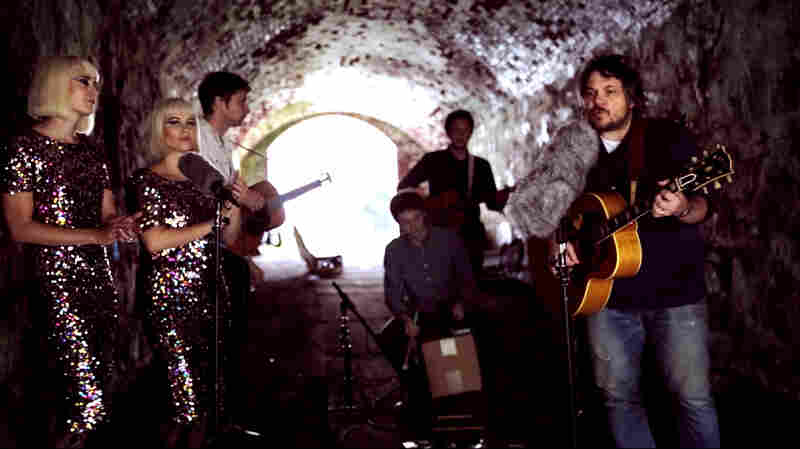 Jeff Tweedy performs with his band Tweedy and guest singers Jess Wolfe and Holly Laessig of Lucius for a Field Recordings video shoot at the Newport Folk Festival.