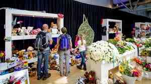 Visitors look at a memorial at Amsterdam's Schiphol
