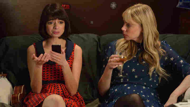 Kate Micucci (left) and Riki Lindhome play a fictional version of their real-life joke-folk duo Garfunkel and Oates in a new scripted comedy on IFC.