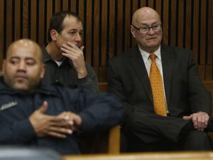 Theodore Wafer (center) and his attorney Mack Carpenter sit in the back of the courtroom Jan. 15 before his arraignment in Detroit in the s