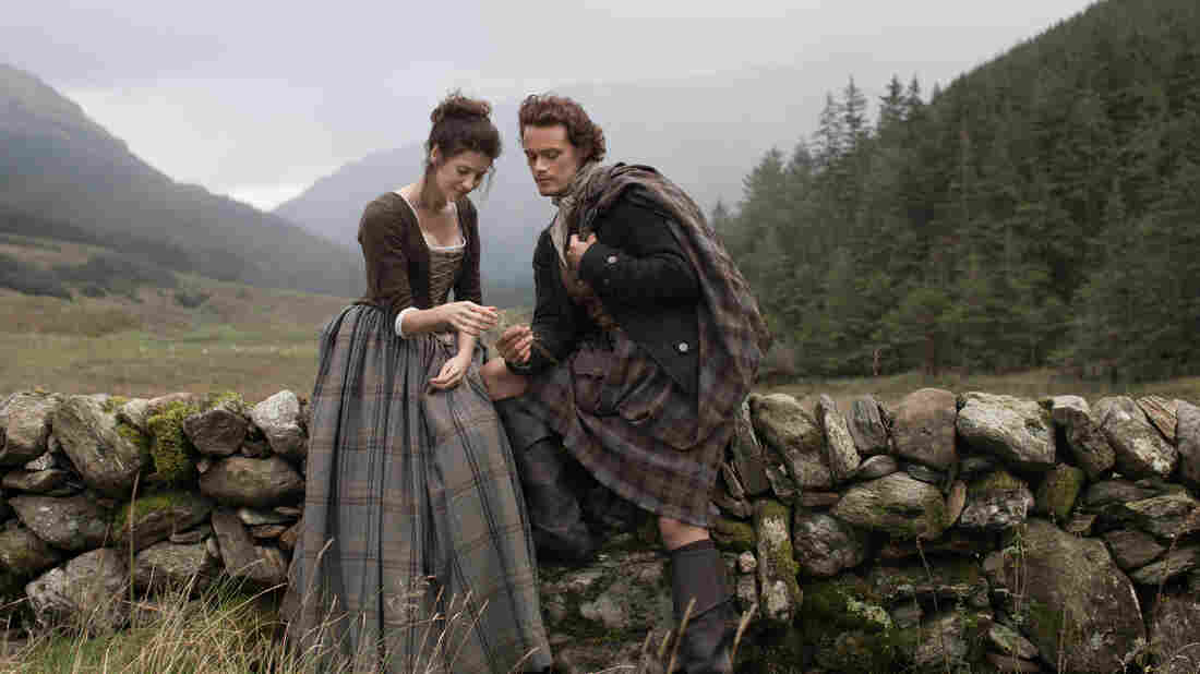 Caitriona Balfe as time-traveling Claire Randall, and Sam Heughan as her Highlander lover Jamie Fraser in the new television adaptation of Outlander.
