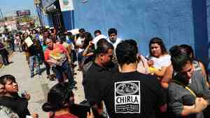 A crowd waits in line to apply for Deferred Action for Childhood Arrivals (DACA) in Los Angeles on the program's first day on Aug. 15, 2012.