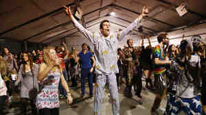 Revelers dance in their pajamas at Morning Gloryville in London in January. The nigh