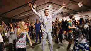 Revelers dance
