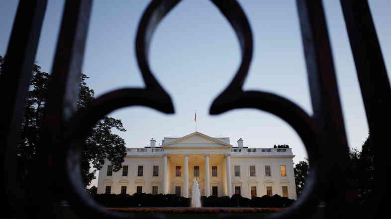The White House, as seen through the fence on Pennsylvania Avenue.