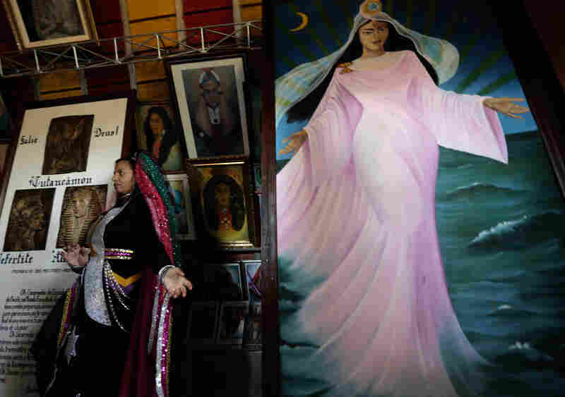 "An image of the Goddess ""Mother Yara"" stands in a temple during an annual gathering celebrating the religious doctrine of the Vale do Amanhecer, near Brasilia, Brazil. The religious community, founded by the medium Tia Neiva, is linked to one of Brazil's many Spiritist movements."