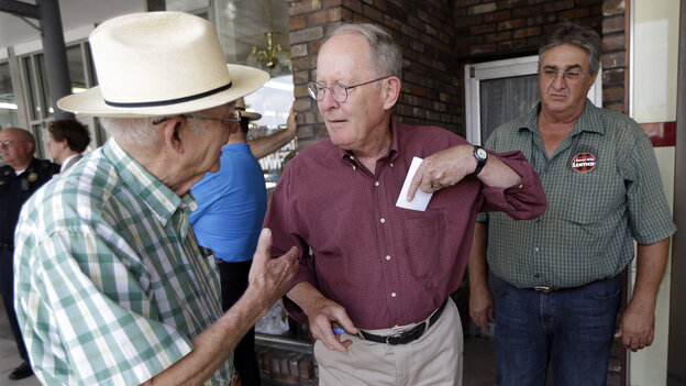 Sen. Lamar Alexander, R-Tenn. (center), talks with Wallace Henson (left) while campaigning in Lawrenceburg, Tenn., on Aug. 5. Alexander fended off a Tea Party-backed challenge Thursday.