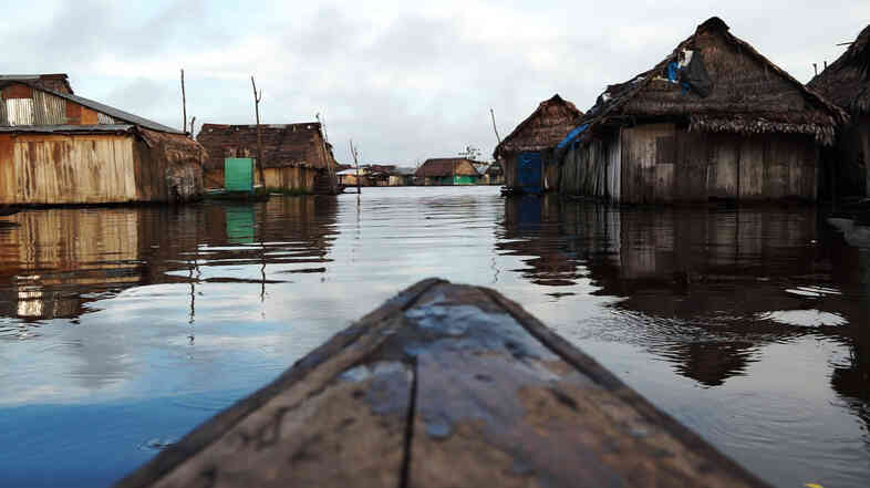 During the rainy season, a canoe is a handy vehicle to have in the waterlogged Peruvian neighborhood of Belen.