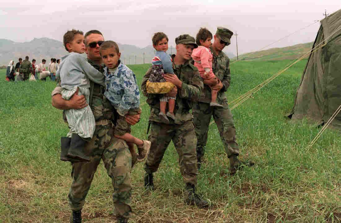 U.S. soldiers carry Ir