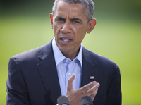 President Obama speaks on the South Lawn of the White House in Washington, on Saturday. He said the situation in Iraq amounts to a