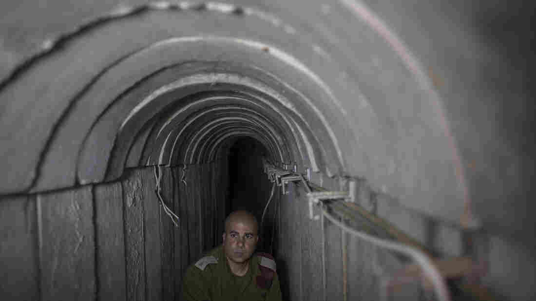 An Israeli soldier stands inside an underground tunnel built by Hamas militants leading from the Gaza Strip into Southern Israel. Israel says it has destroyed 32 similar tunnels so far in the nearly monthlong conflict.