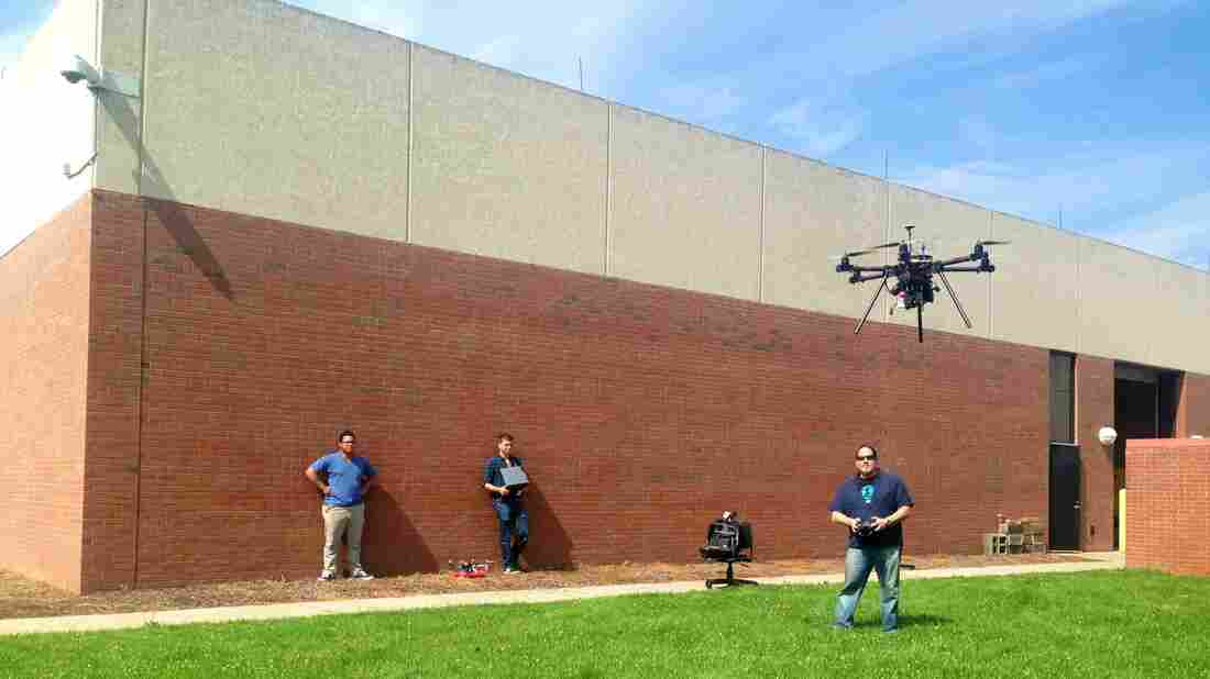 Steve Cohen and his students fly a drone at Bergen Community College in New Jersey. The FAA prohibits drones from flying above 400 feet or from being used for commercial gain.