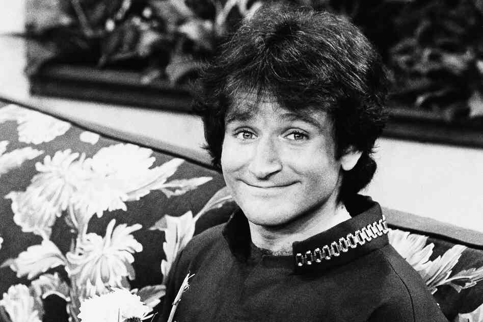 Williams on the set of ABC's Mork & Mindy in 1978. His character, Mork, first appeared on the show Happy Days before being spun off into its own show.
