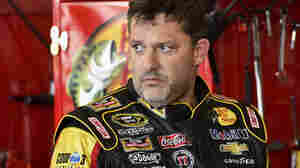 Tony Stewart is seen Friday preparing for Sunday's NASCAR Sprint Cup Series race at Watkins Glen, N.Y. Police say no charges are pending against Stewart in the death of another driver at a nearby dirt track Saturday.