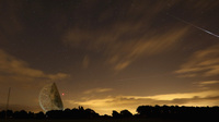A Perseid meteor streaks across the sky over the Lovell Radio Telescope in Holmes Chapel, U.K., on Aug. 13, 2013.