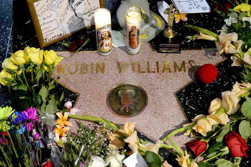 Flowers are placed on Williams' Walk of Fame star in Los Angeles on Monday. Williams was pronounced dead at his San Francisco Bay Area home Monday, according to the sheriff's office in Marin County, Calif.