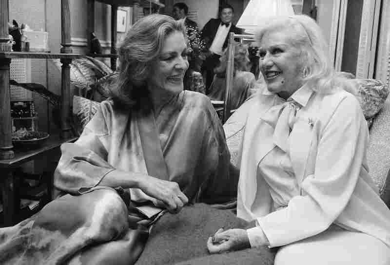 Ginger Rogers, right, visits backstage with Bacall at the Palace Theater in New York in 1981 after seeing Bacall in her Broadway show, Woman of the Year.