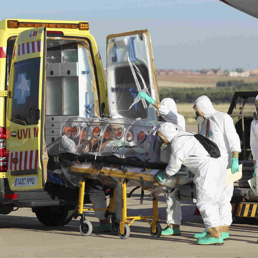 Miguel Pajares, a Spanish priest who was infected with the Ebola virus while working in Liberia, is transferred from a plane to an ambulance after arriving in Spain. He was treated with an experimental drug but died on the disease.