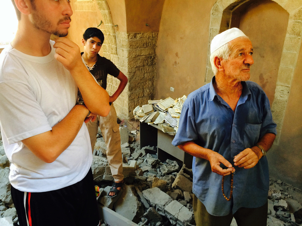 Mohammad Alloush (left), a 22-year-old student, and Jowdet al-Najjar, 70, worship at Omari mosque. They say a mosque has existed on this site for 13 centuries.