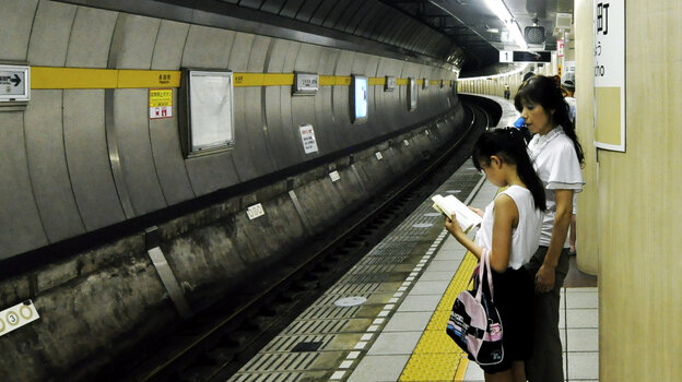 A child waits for the subway to arrive in Tokyo. Kids under 10 are often allowed to take the train by themselves.