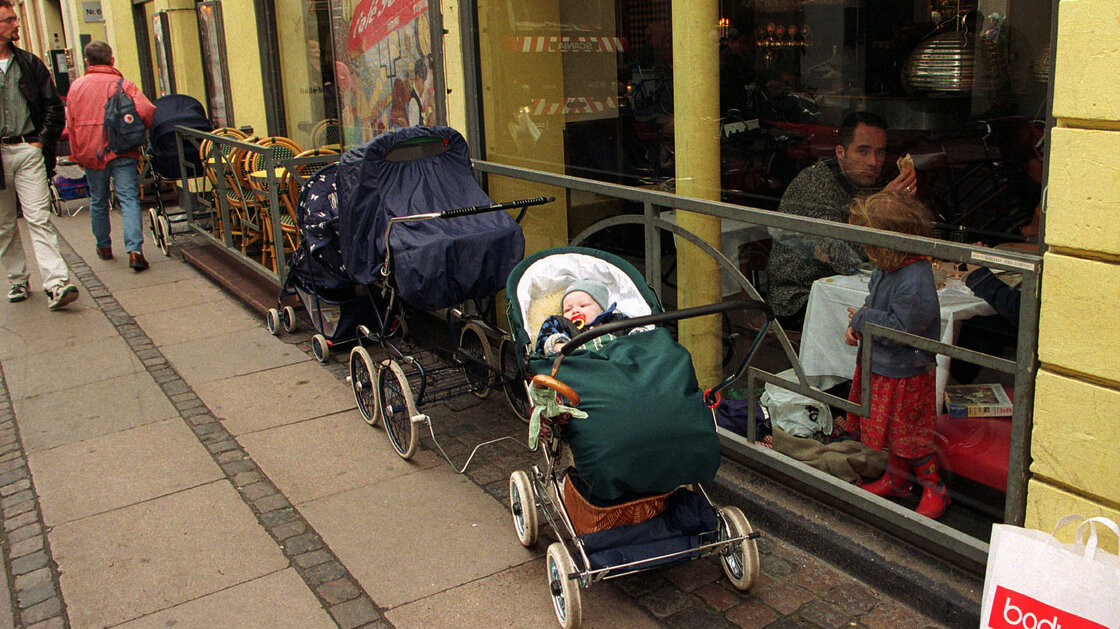 Babies in their strollers are parked outside a cafe in Copenhagen, a common sight in Denmark.