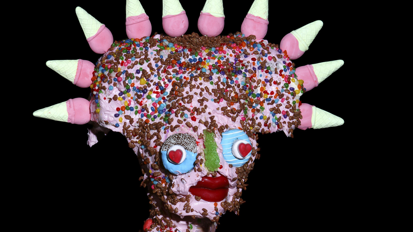 Beneath These Masks Is An Artist Conflicted By Junk Food