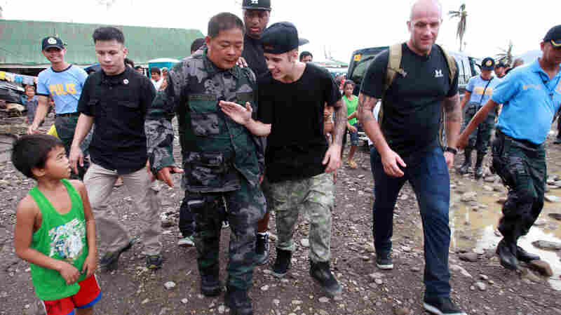 Justin Bieber may have a bad boy side, but the angelic Bieber launched a campaign to raise money for victims of Typhoon Haiyan, which struck the Philippines last year. Here, he visits a Filipino elementary school. And he took the Ice Bucket Challenge — twice. And urged Beliebers to do the same.