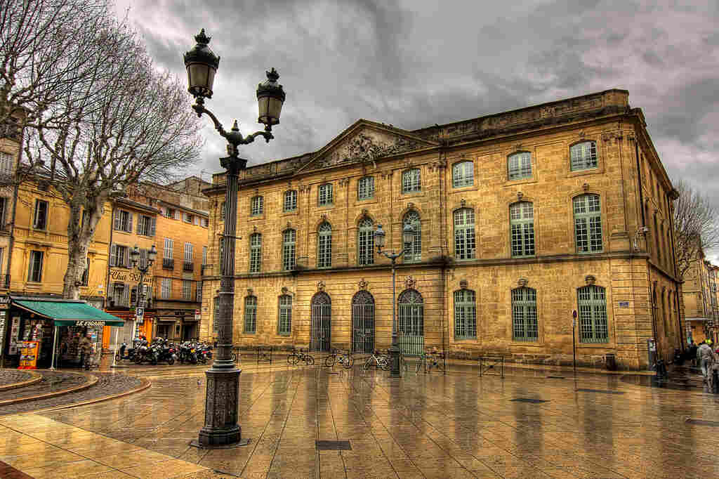 """Behind the """"carved wooden doors and the chiseled golden stone facades, there's a lot of mystery"""" in Aix, Longworth says."""