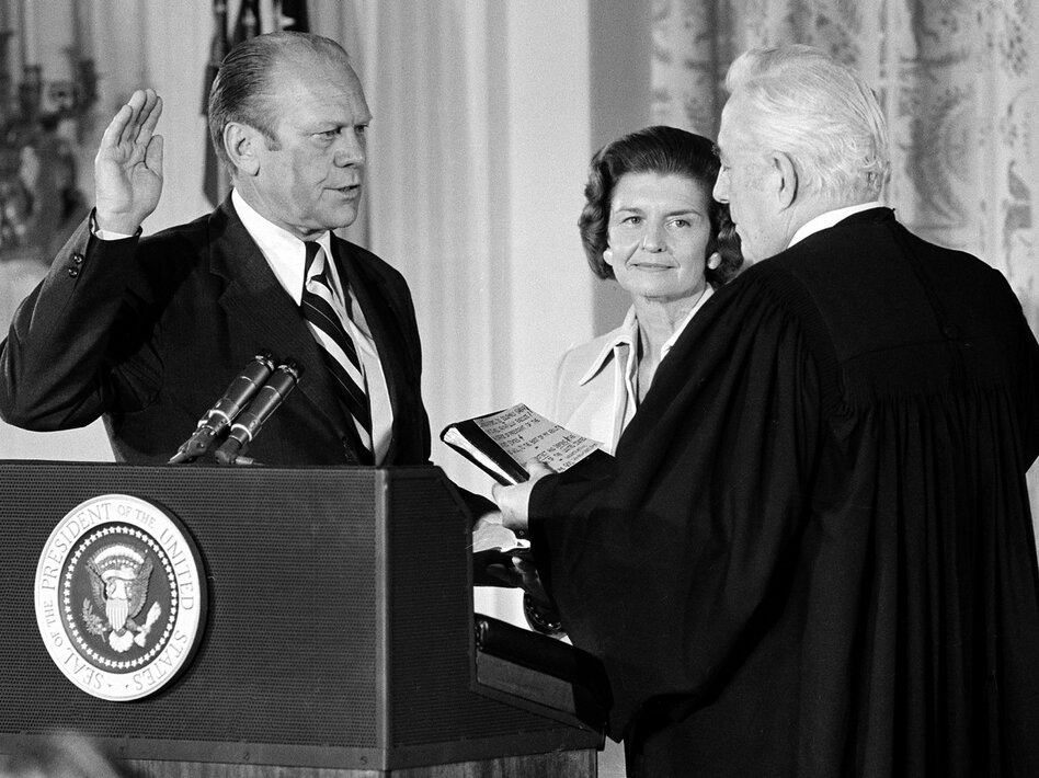 U.S. Chief Justice Warren Burger administers the oath of office to Gerald Ford in the East Room of the White House in Washington, D.C., August 9, 1974.